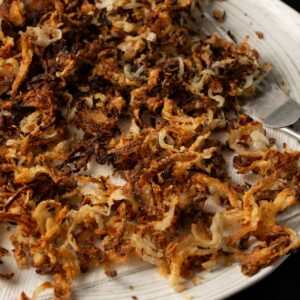 A platter of thinly sliced crispy onions.