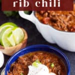 Short Rib Chili in a bowl with toppings.