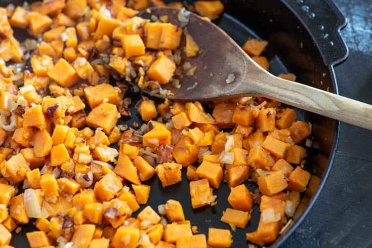 A skillet of sweet potatoes for Sweet Potato Frittata