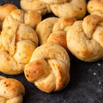 Sour cream bread rolls on a black board
