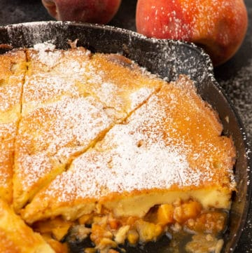 A skillet of Peach Dutch Baby Pancake