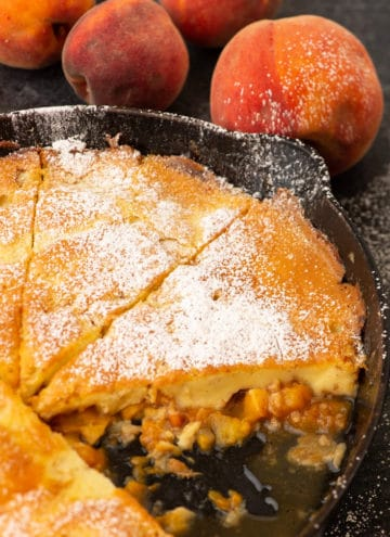 A skillet of Peach Dutch Baby Pancake