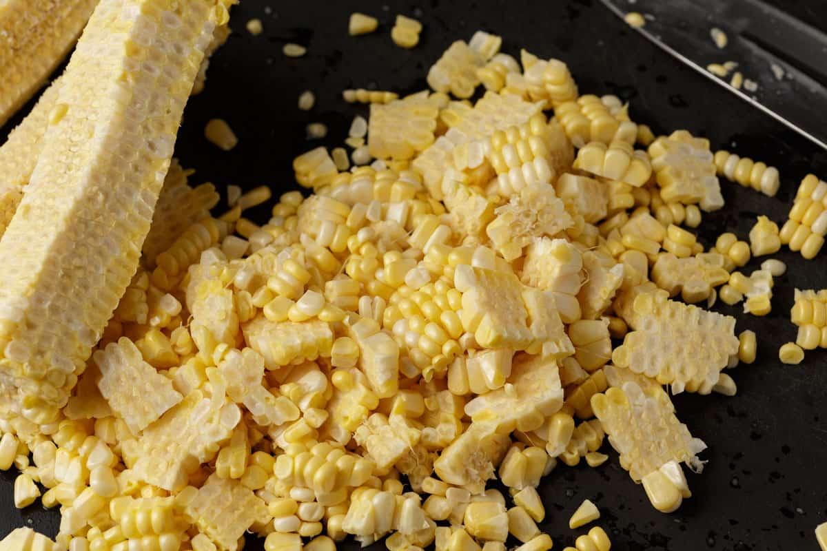 Fresh corn cut off the cob on a cutting board