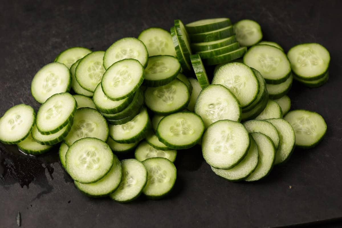 Sliced cucumbers on a cutting board
