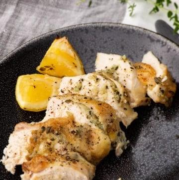 A serving platter of sliced Lemon Garlic Chicken
