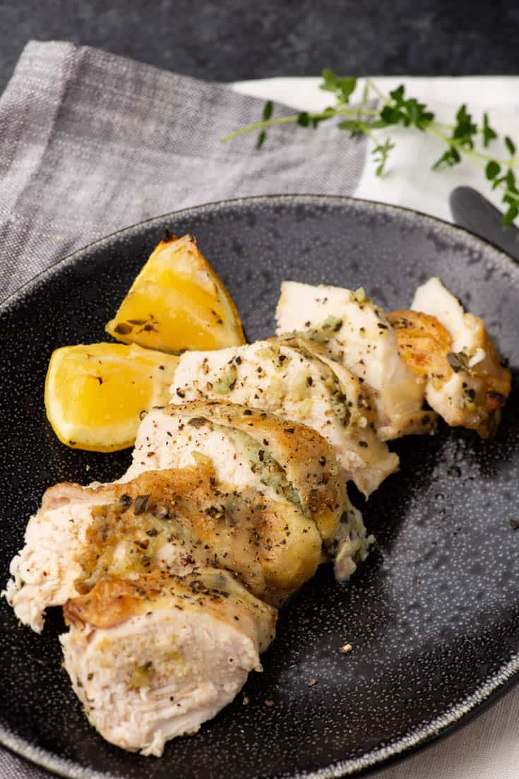 A serving platter of sliced Lemon Garlic Chicken