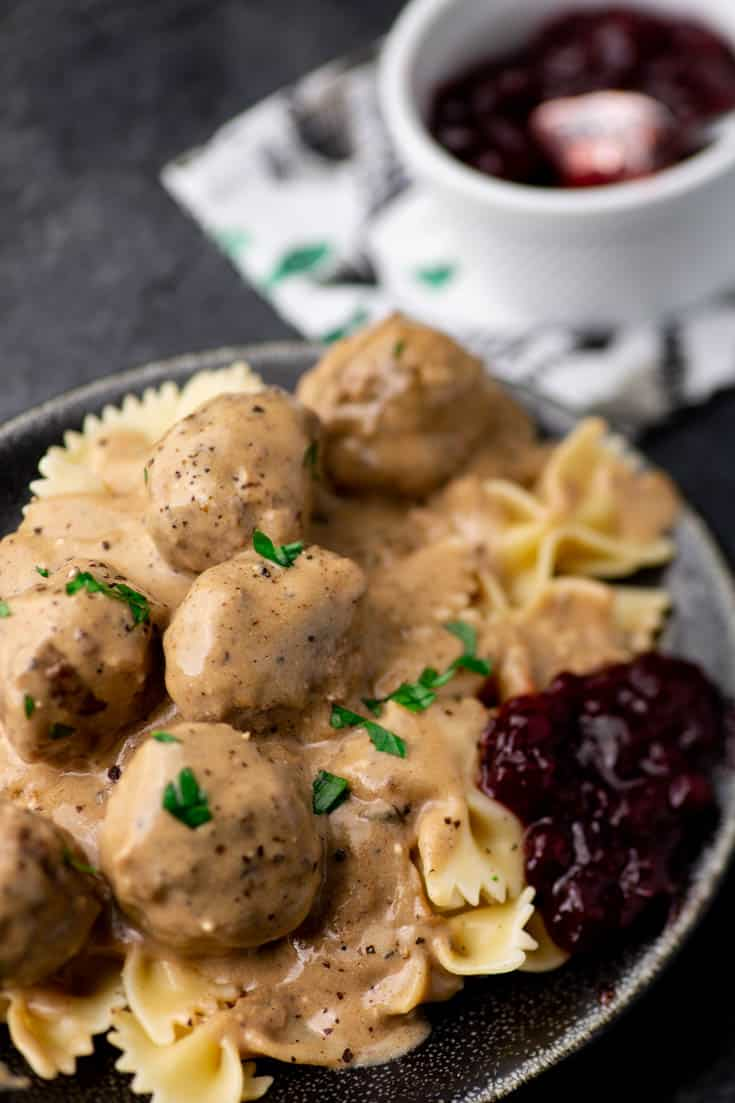 A plate of Swedish Meatballs with a scoop of Lingonberry Jam
