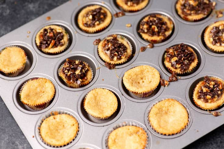 A pan half full of the filling for chocolate chip tarts
