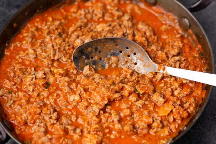 A skillet of sausage with vodka sauce