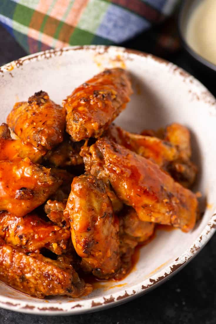 A white bowl of crispy Buffalo Chicken wings