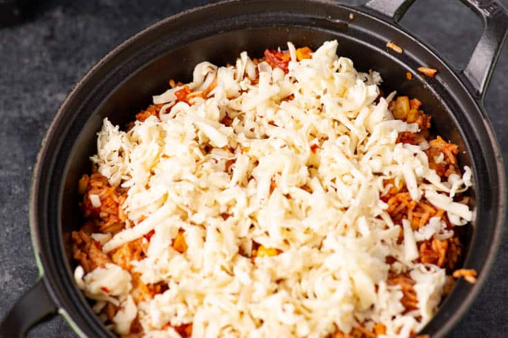 A pot of southwest chicken and rice with pepper jack cheese