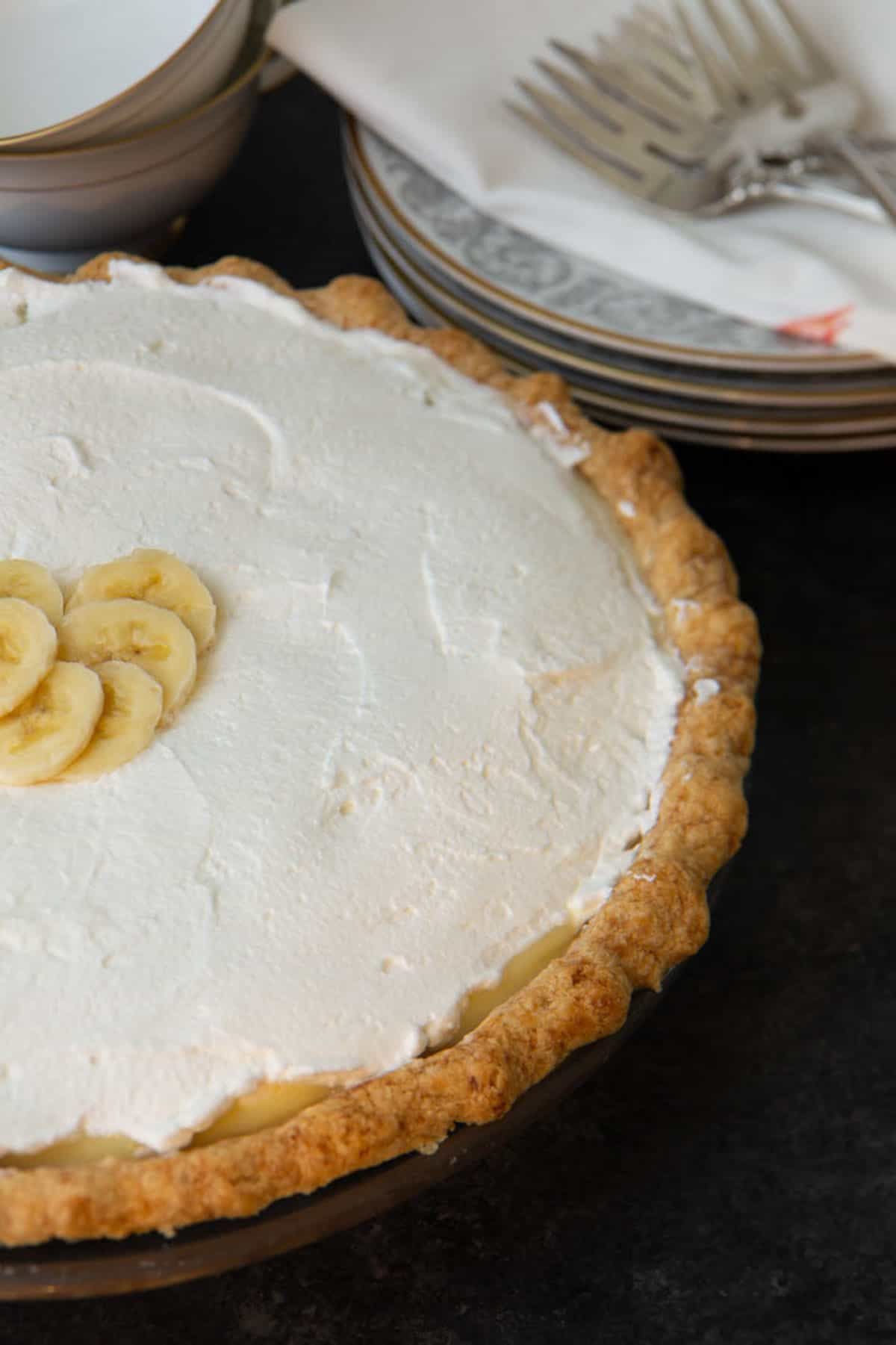 An entire banana cream pie topped with whipped cream