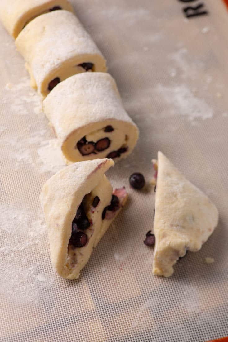 A roll of blueberry scone dough