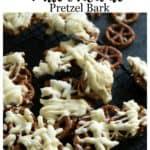 A batch of white chocolate pretzel bark on a black board