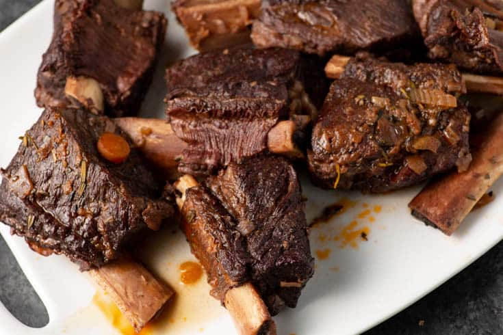 A platter of cooked beef short ribs