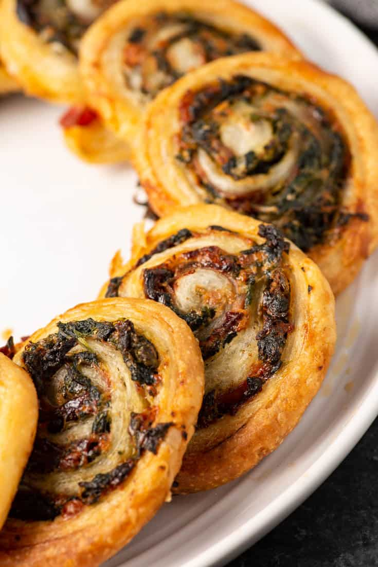 A plate of pinwheels with spinach