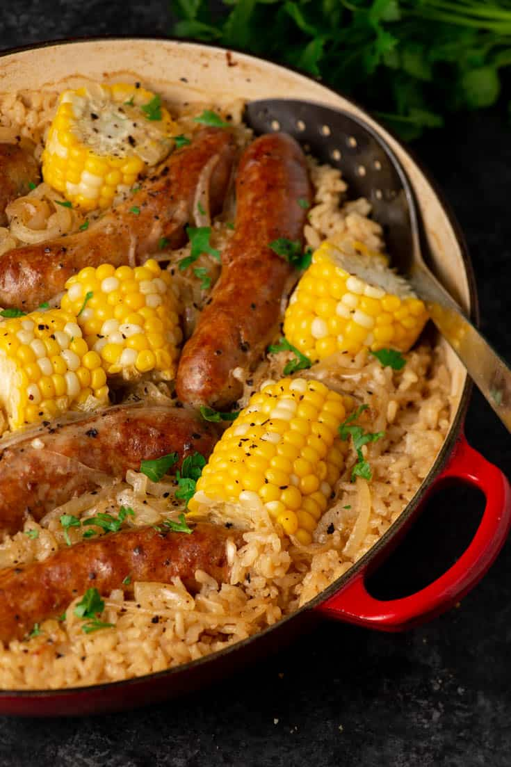 A skillet of baked rice with Italian sausage and corn