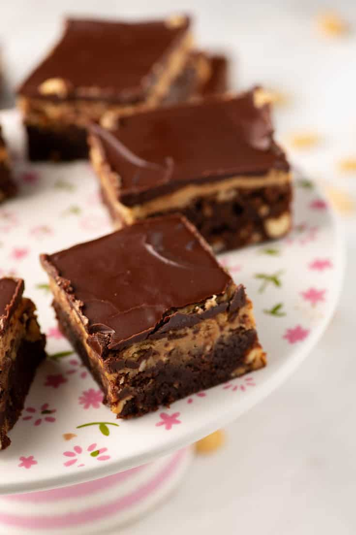 A cake platter with peanut butter brownies