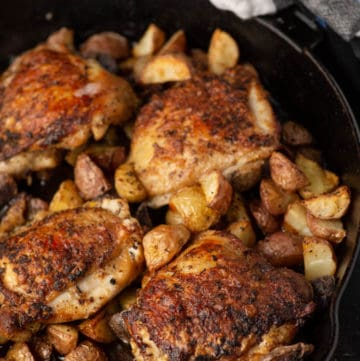 Lemon mustard chicken with potatoes in a skillet