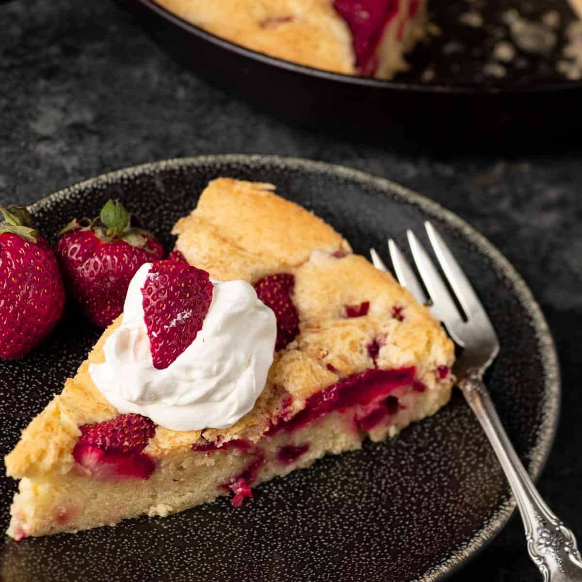 Strawberry pound cake on a plate with a fork
