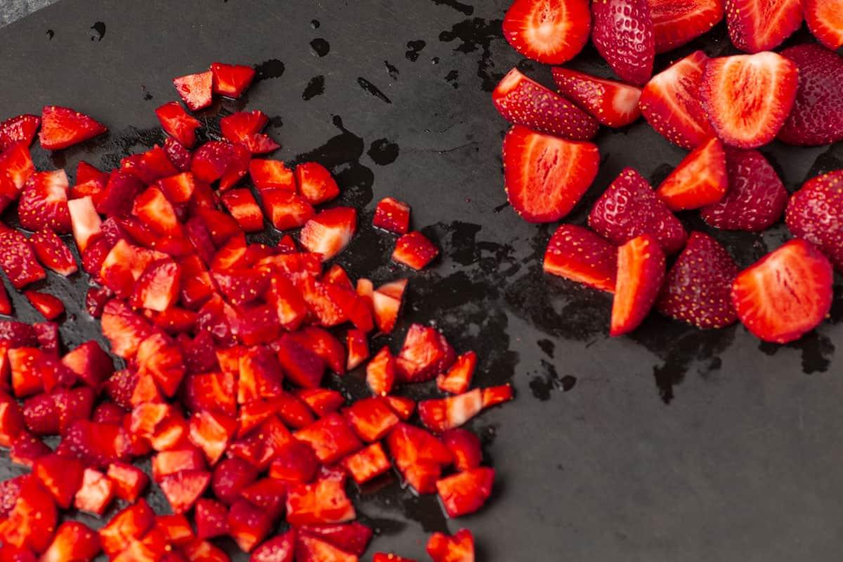 Fresh cut strawberries on a cutting board