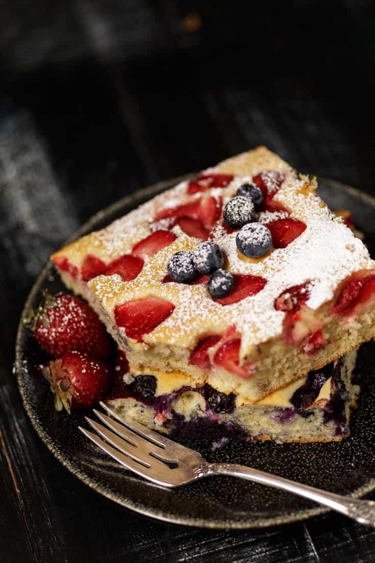 A serving of sheet pan pancakes with powdered sugar