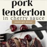 A platter of pork tenderloin with a black fork and a colander of cherries