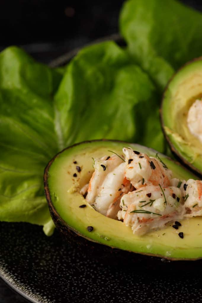 An avocado stuffed with old bay shrimp salad
