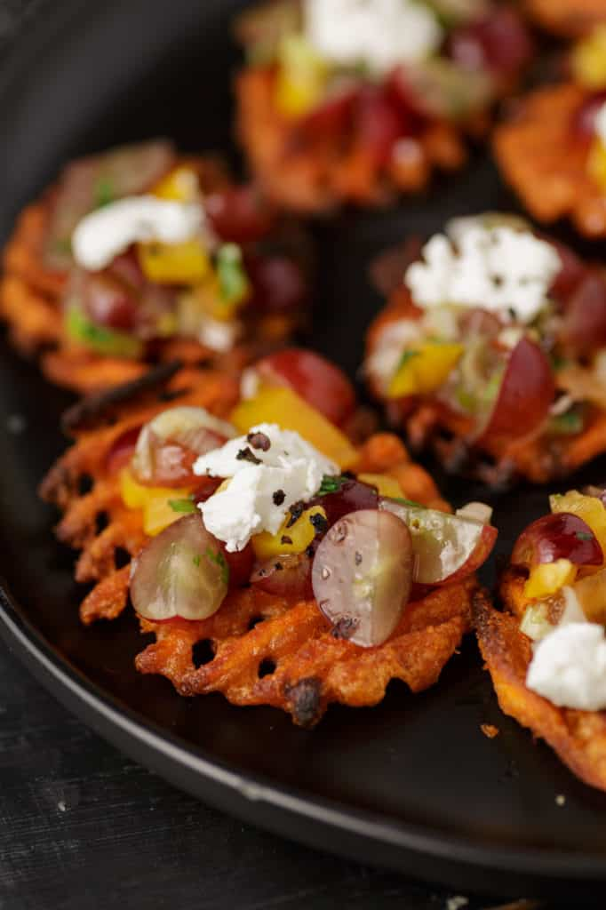 Sweet potato fries topped with grapes