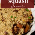 A baking dish of butternut squash crumble with a spoon full of squash