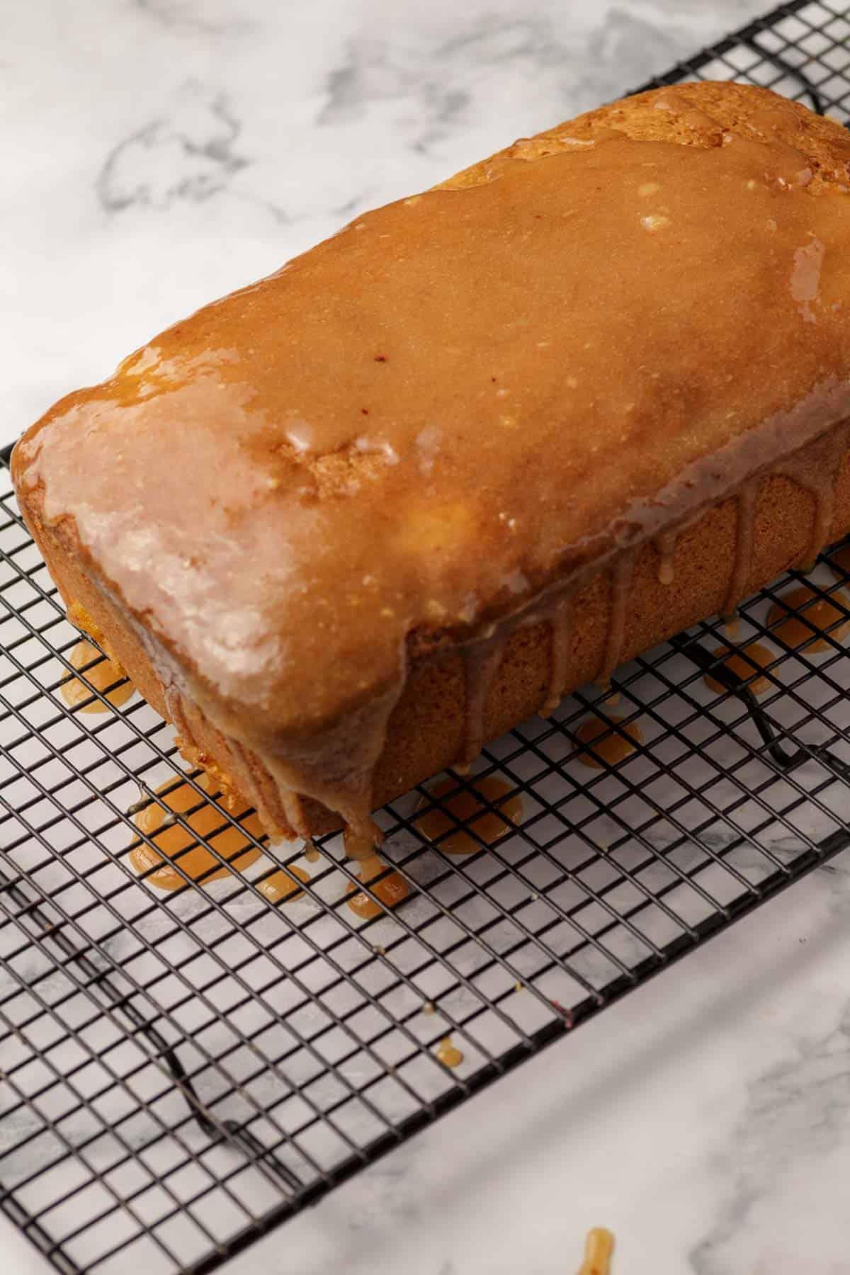 A peach pound cake covered in glaze