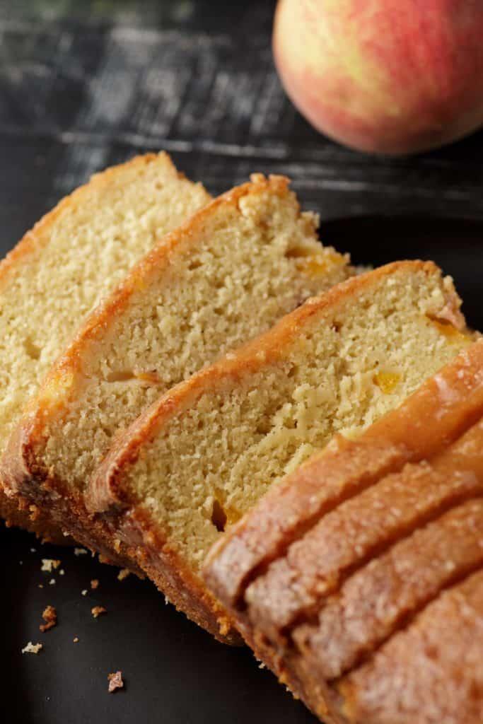 A sliced peach pound cake