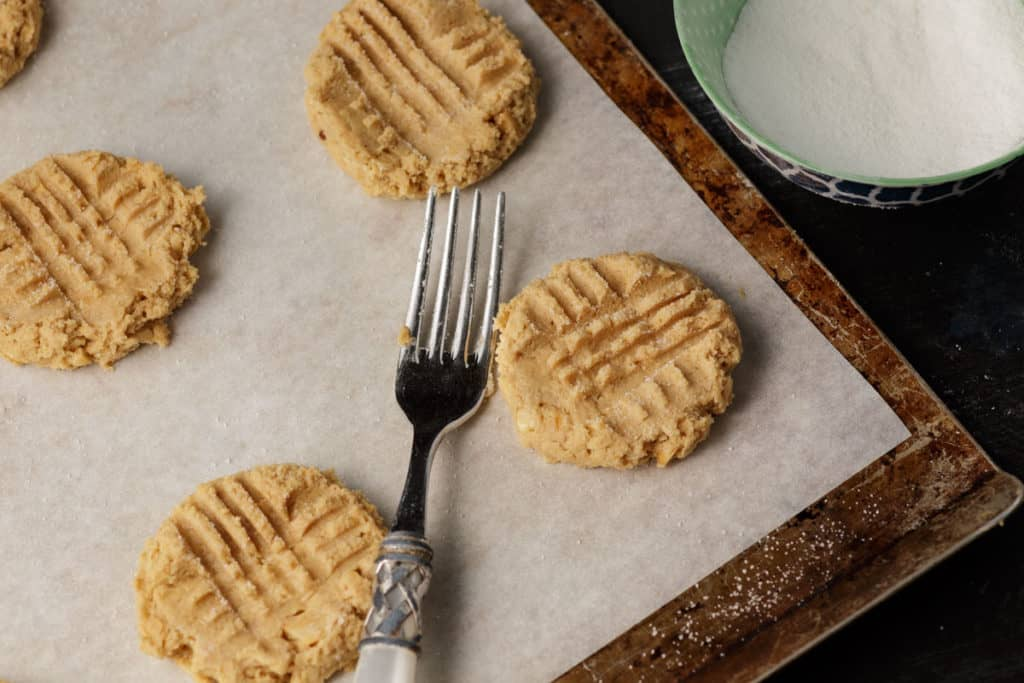 A baking sheet of cookies with a fork