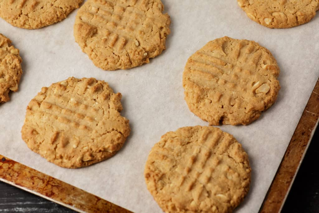 Baked peanut butter cookies on parchment