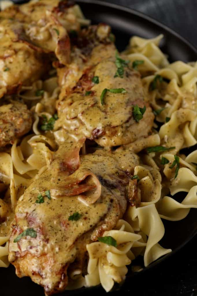 Creamy pesto chicken over pasta