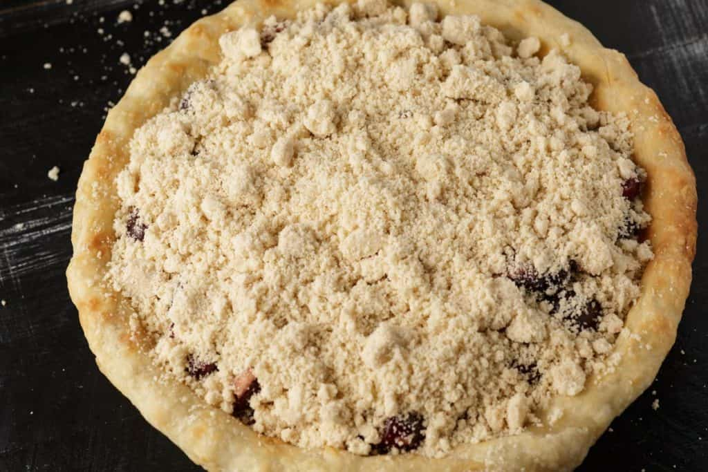 A cherry pie topped with a crumble topping