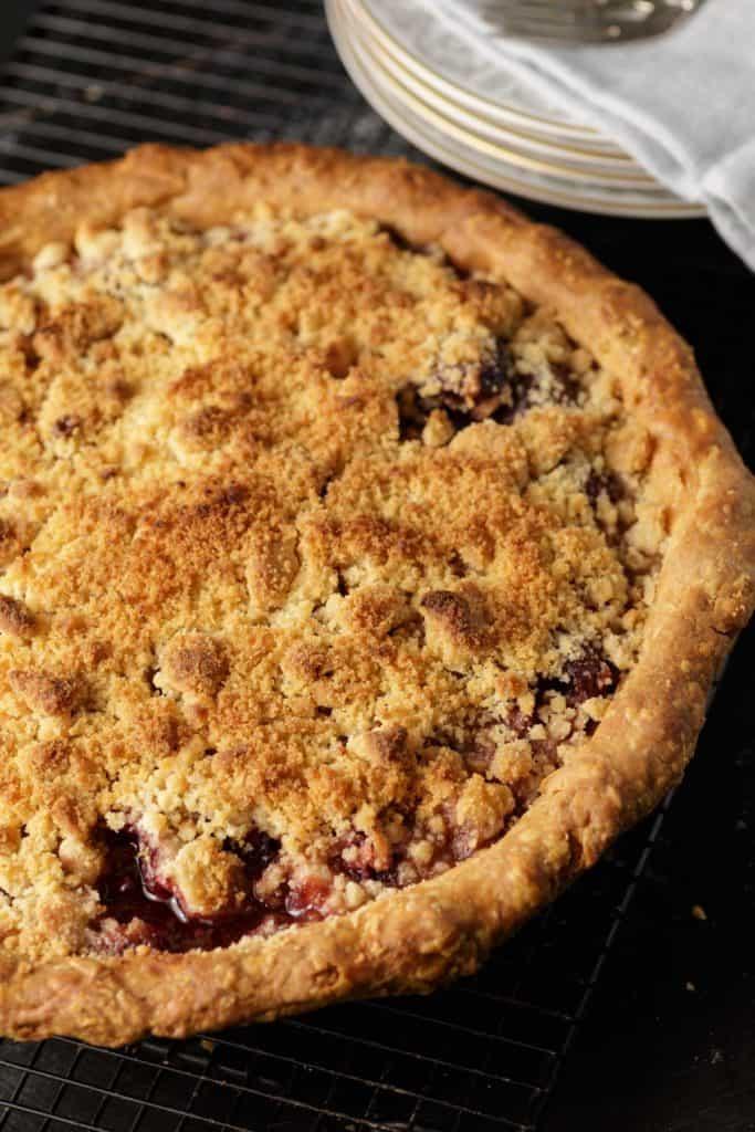 A baked cherry streusel pie
