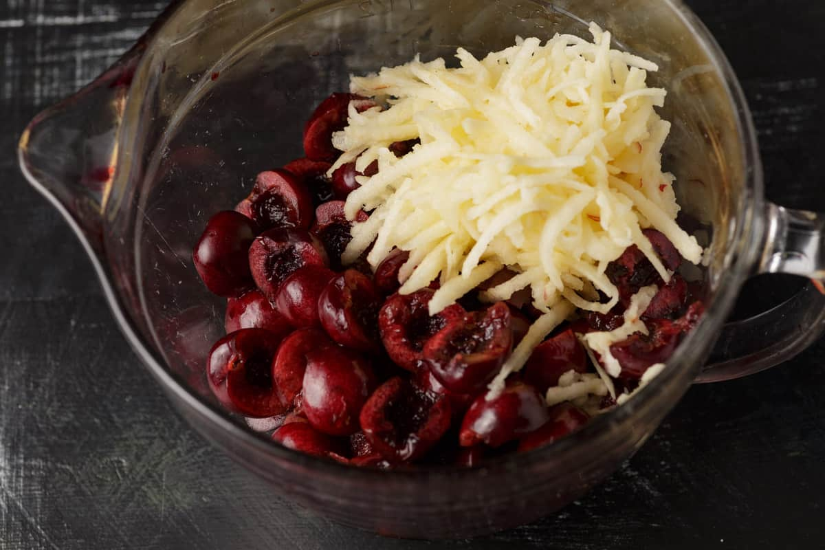 A bowl of cherries and grated apple