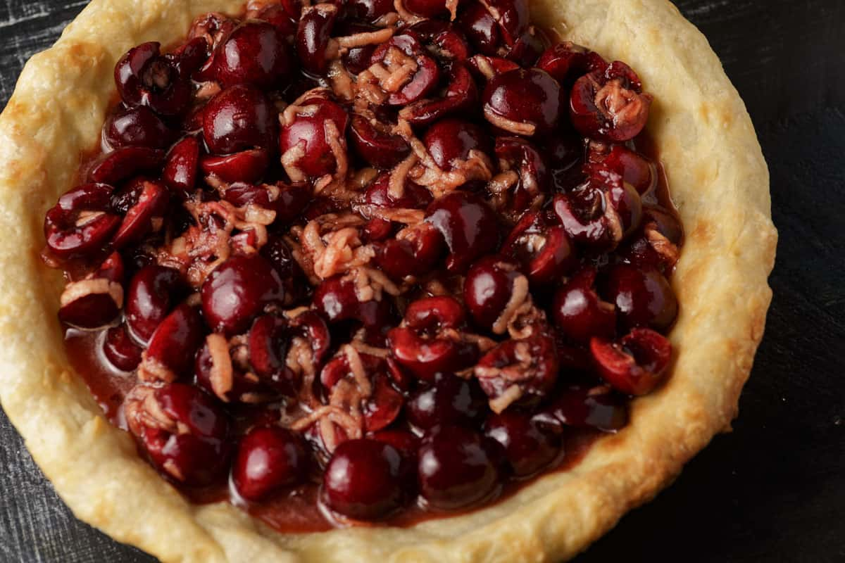 Cherry filling in a partially baked pie crust
