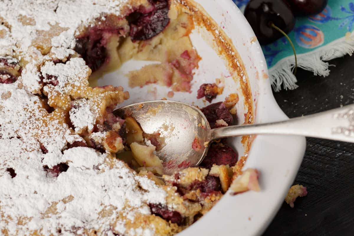 A casserole dish with cherry clafoutis