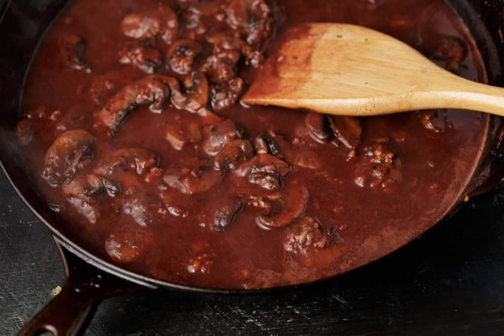 A skillet of red wine sauce