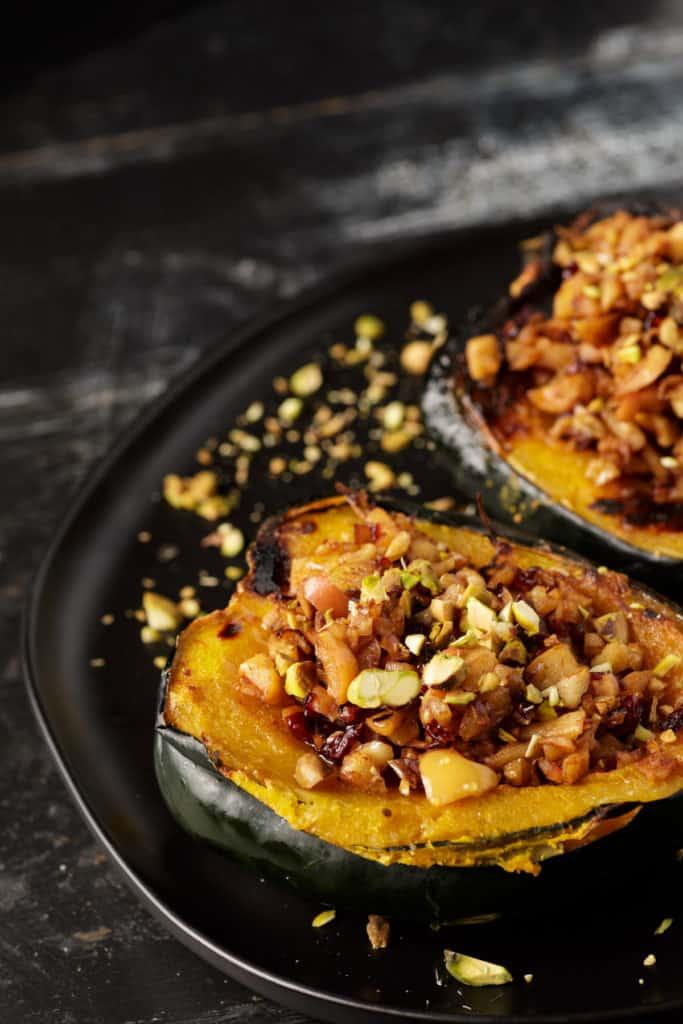 Stuffed acorn squash on a platter