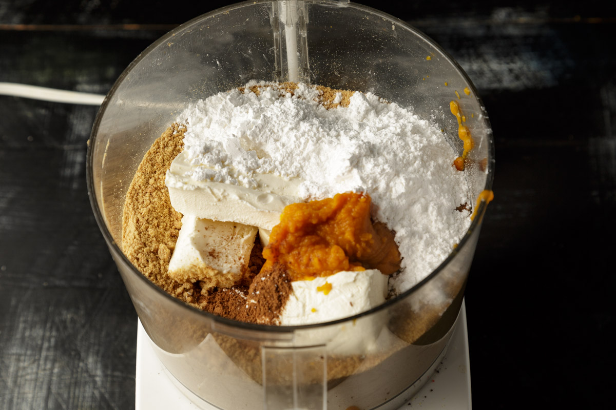 The ingredients for pumpkin truffles in a  food processor