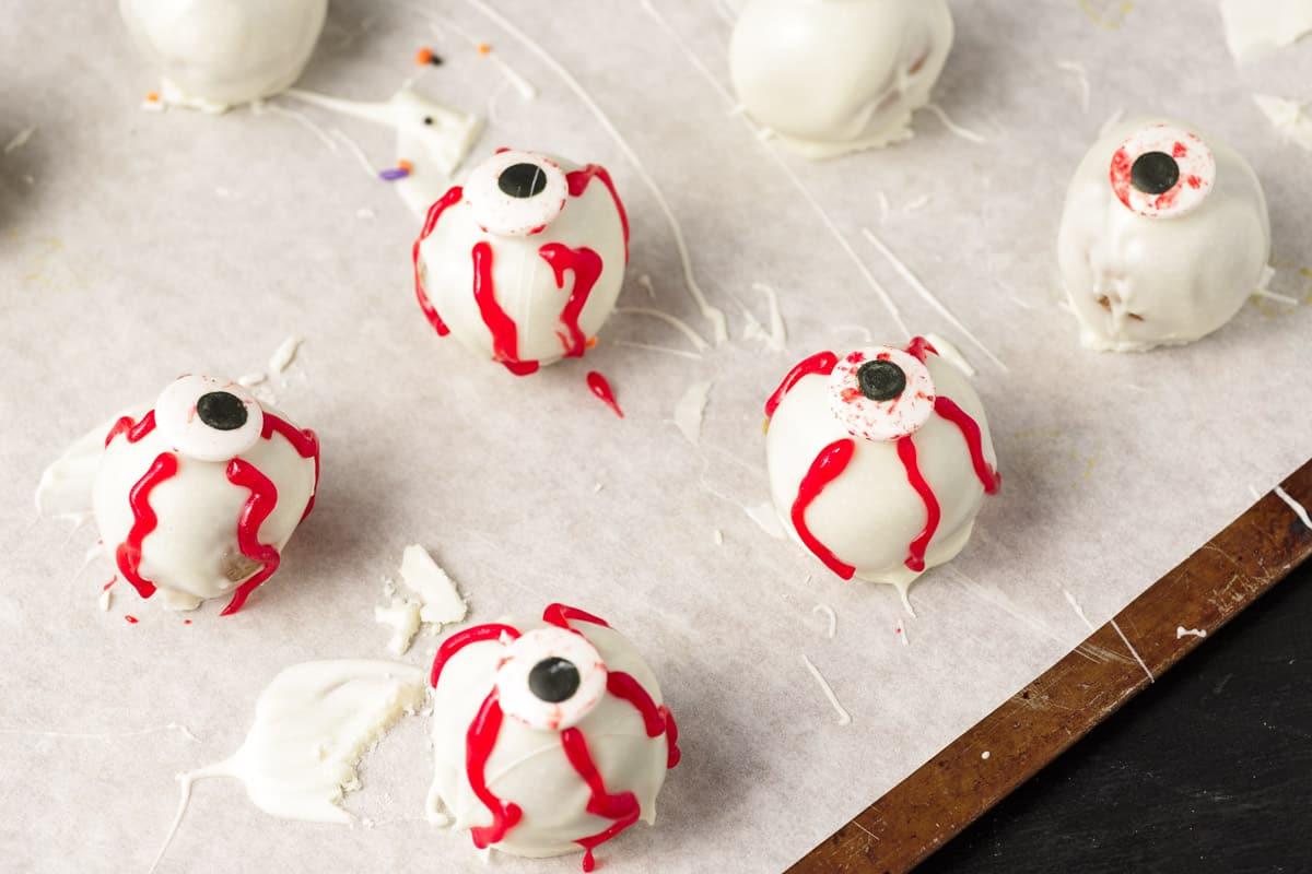 Monster eyeball pumpkin cheesecake balls