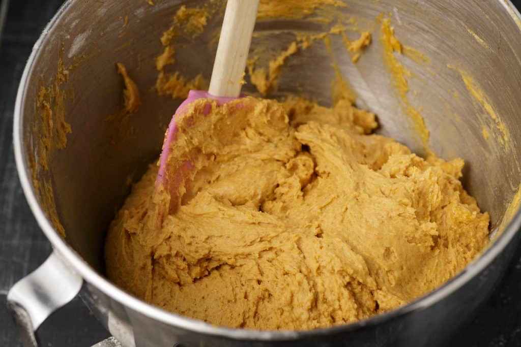 A mixing bowl of pumpkin cookie dough