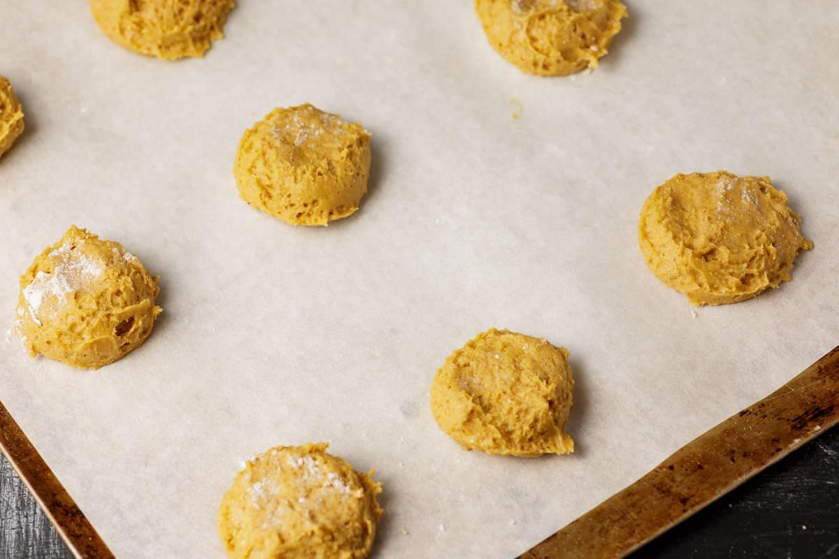 Pumpkin cookie dough on a baking sheet