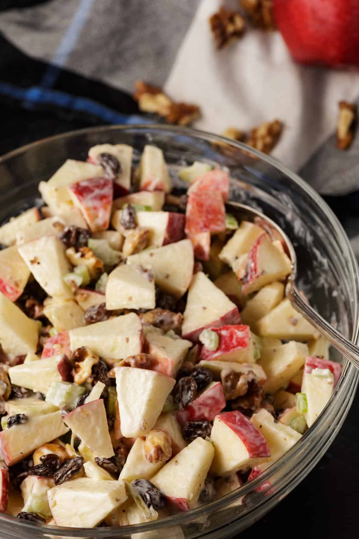 A bowl of waldorf apple salad in a glass bowl