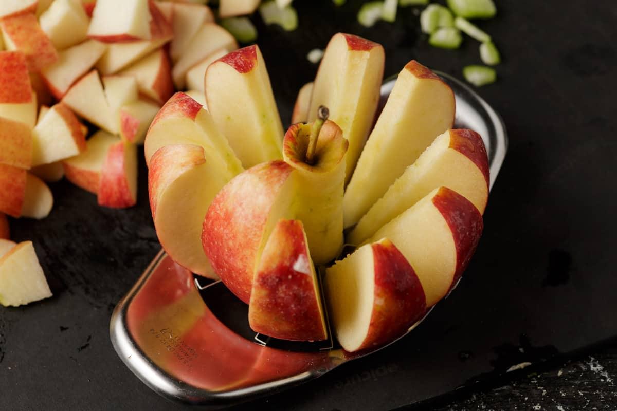 An apple slicer cutting an apple
