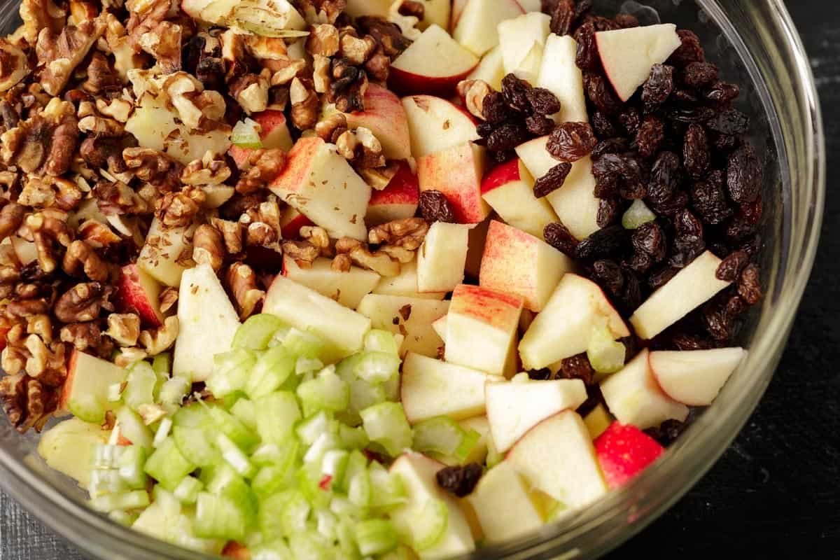 A bowl of ingredients for apple salad