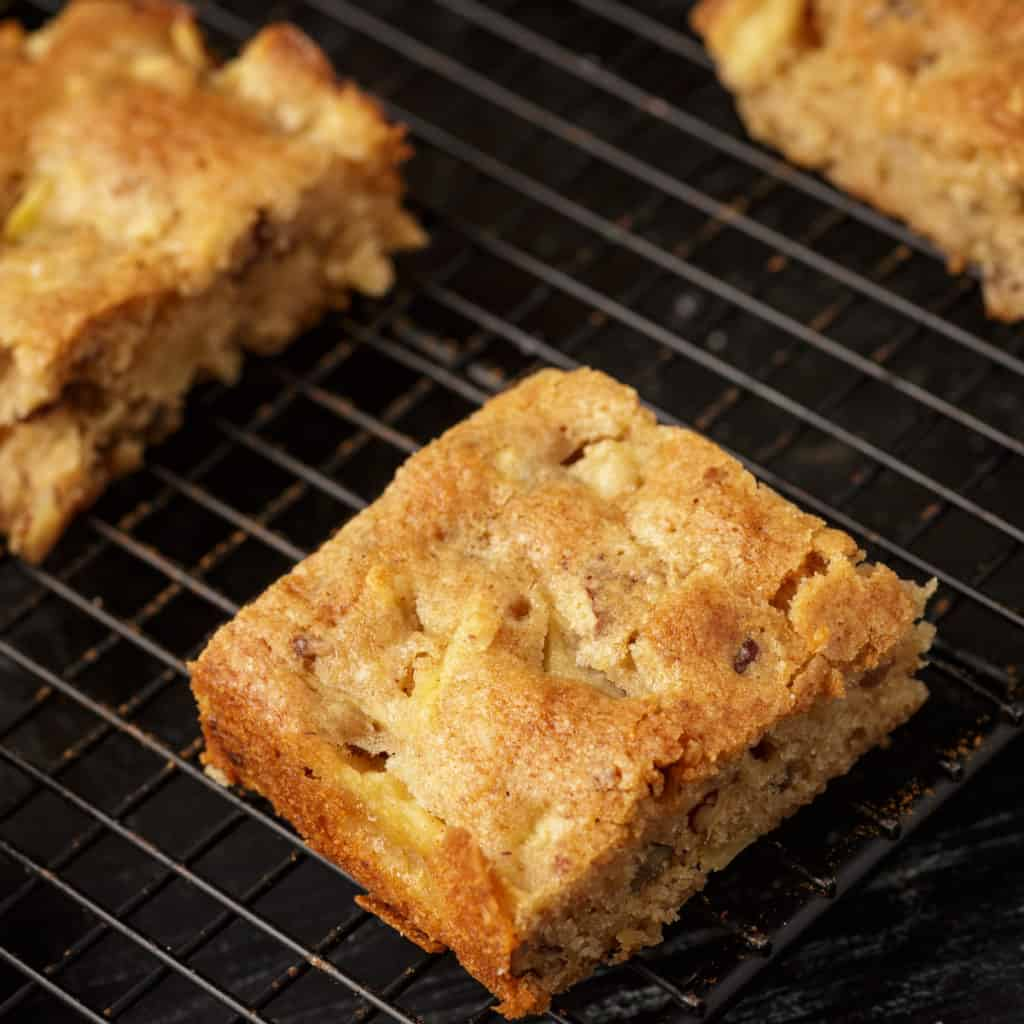An apple blondie on a baking rack